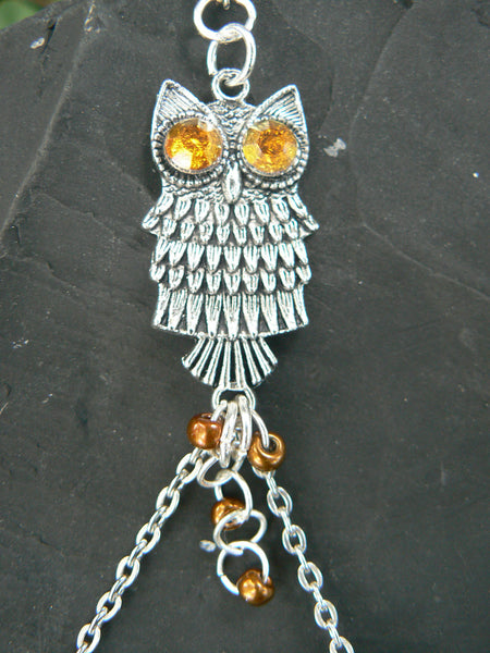 owl slave bracelet amber color eyes in hipster fantasy style