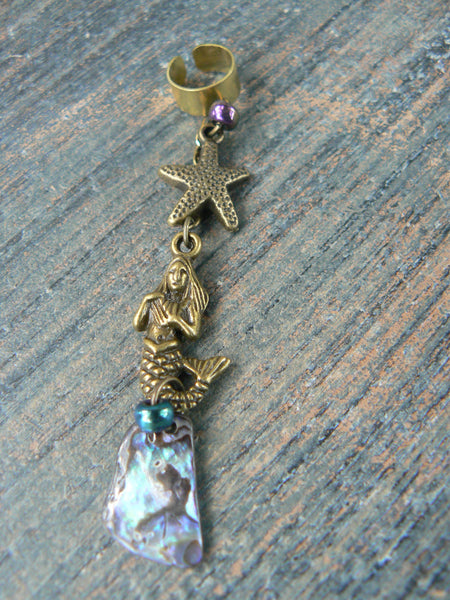 mermaid abalone ear cuff with starfish in brass