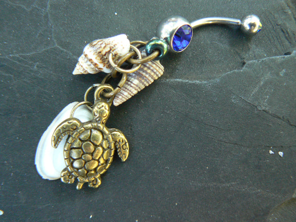 sea turtle belly ring in brass with shells