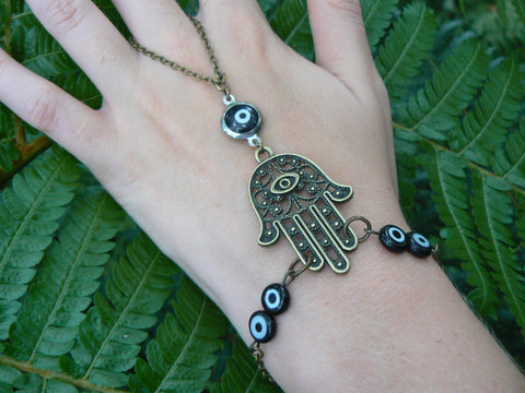 hamsa hand slave bracelet  brass with  black evil eyes