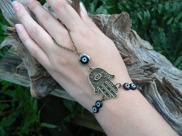 hamsa slave bracele brass witht black evil eyes