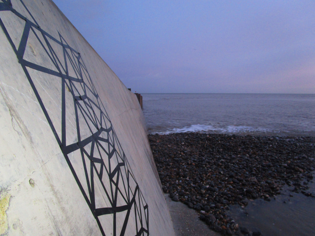 Cromer Sea wall. Tape graffiti on a wall creating a Dabatag t-shirt desing hand printed in Cromer, Norfolk, Uk