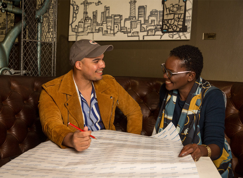 Jimmy Nevis and Joy Ezeka Unwrapping-Happiness-Christmas-Wrapping-Paper-Design Colab-Novus-Holdings
