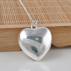 Image of Glow In The Dark Silver Hollow Heart Glowing Stone Necklace