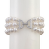 Three-strand pearl and crystal bracelet