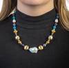 Vibrant gold, pearl, and gemstone necklace