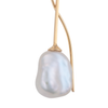 A close- up image of a white keshi pearl earring on a 9ct gold setting.
