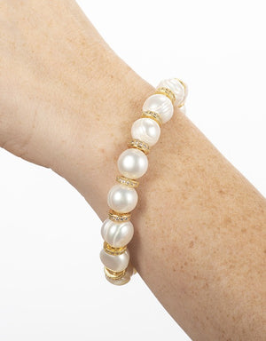 Pearl and round gold disc bracelet