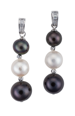 An image of black and white three pearl earrings, with crystal accents.
