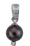 A close-up image of a freshwater cultured black pearl, part of black and white three pearl earrings, with crystal accents.