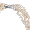 A close-up of a image of a five-strand white cultured keshi pearl necklace with a magnetic clasp