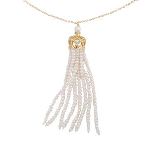 A close-up of a long gold and white freshwater cultured pearl tassel necklace