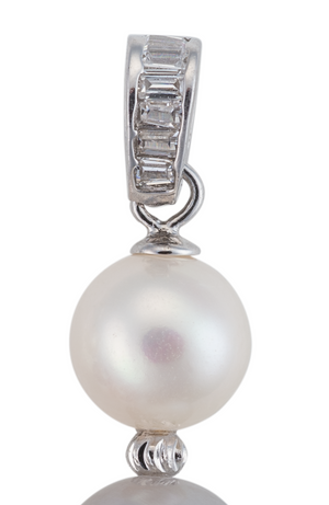 A close-up image of a freshwater cultured white pearl, part of pink, gray, and white three pearl earrings, with crystal accents.