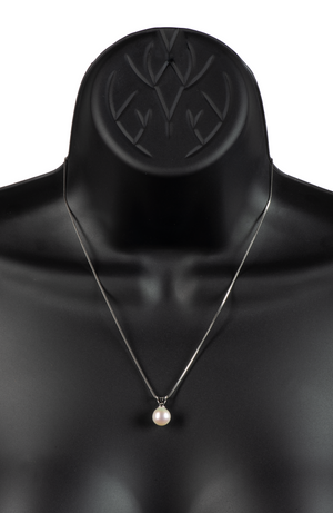 An image of a single white freshwater cultured pearl on a .925 sterling silver setting and chain on a black mannequin