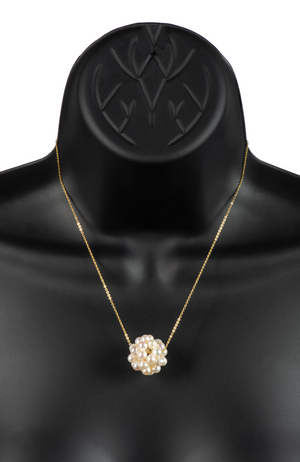 An image of a white snowball pearl cluster necklace on a gold chain on a black mannequin