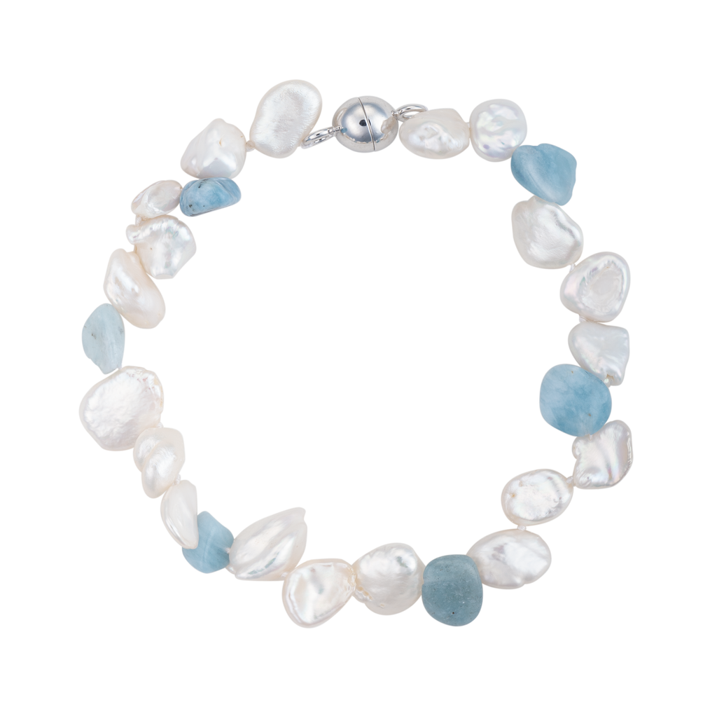 An image of an aquamarine and keshi pearl bracelet with magnetic clasp