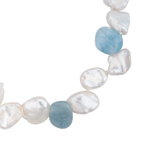 A close-up of an aquamarine and keshi pearl bracelet with magnetic clasp