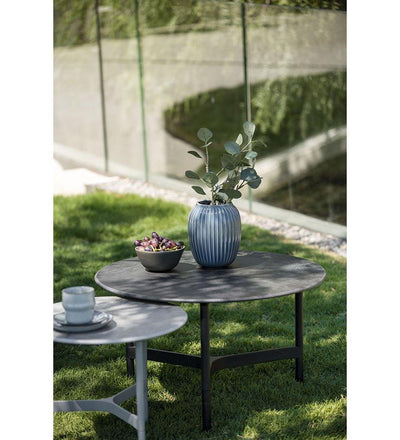 lifestyle, Cane-line Twist Large Coffee Table in Lava Grey Aluminum and Black Fossil Ceramic Top 5012AL P90COB