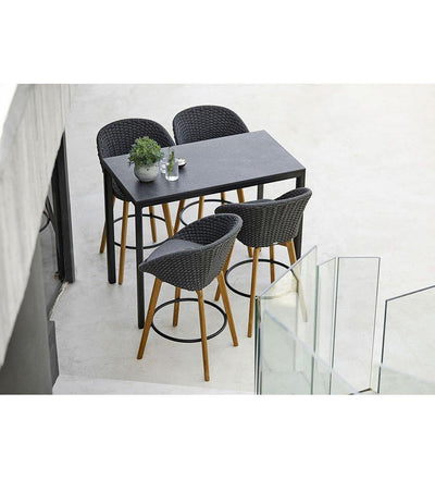 lifestyle, Cane-line Peacock Outdoor Bar Stool in Dark Grey Rope, Teak Legs and Grey Cushion 5455RODGT YSN95