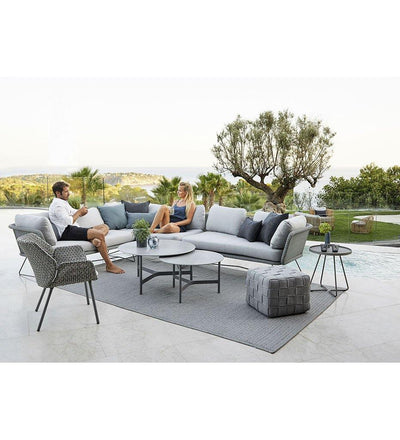 lifestyle, Cane-line Twist Large Coffee Table in Light Grey Aluminum and Grey Fossil Ceramic Top 5012AI P90COG