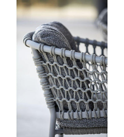 lifestyle, Cane-line Ocean Outdoor Dining Arm Chair with Taupe Rope and Dark Grey Wove Cushions 5417ROT YN115