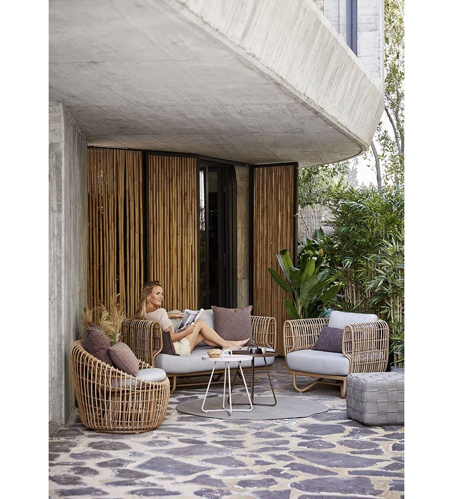 lifestyle, Cane-line Nest Outdoor Round Lounge Chair in All Weather Natural Rattan and Light Grey Cushion 57422USL