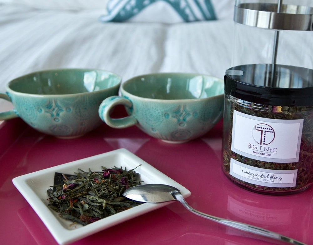 Big T NYC unexpected Fling organic Sencha green tea loose leaf on bed with anthropologie tea cups and pottery barn serving tray