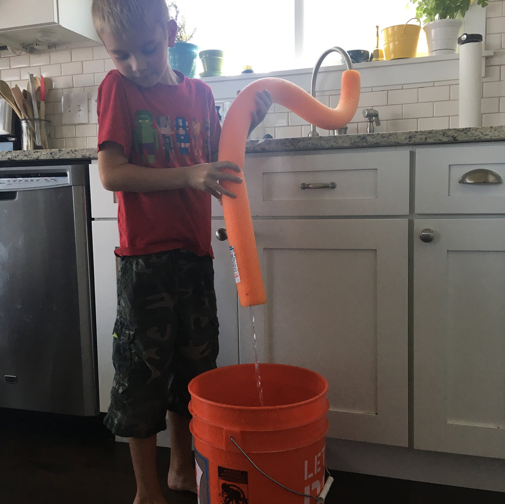 Mom Hacks: Using pool noodles to fill buckets