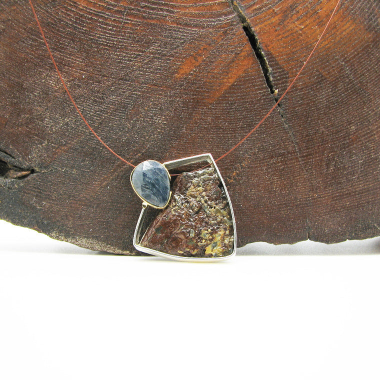 Sterling silver and yellow gold pendant with blue sapphire