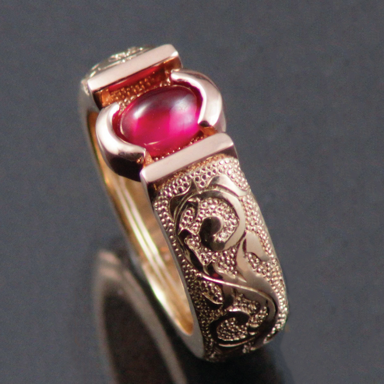 14kt yellow and red gold ring set with a cabachon ruby