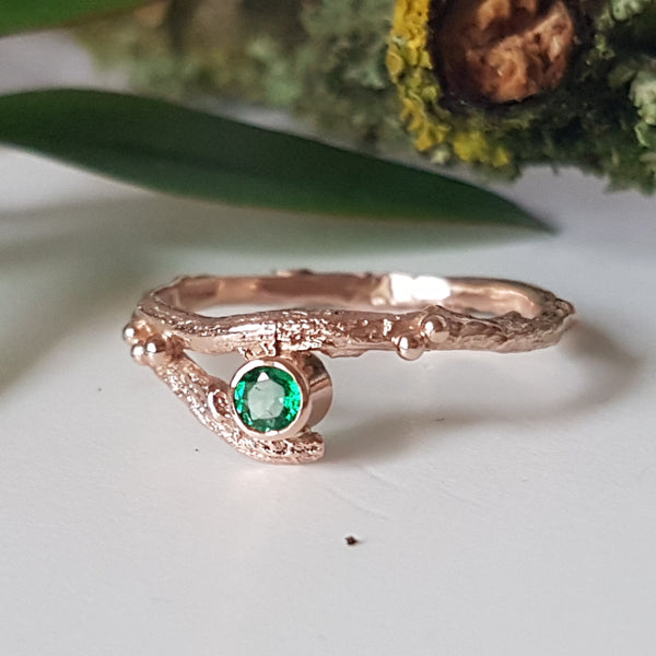 red gold and emerald twig engagement ring