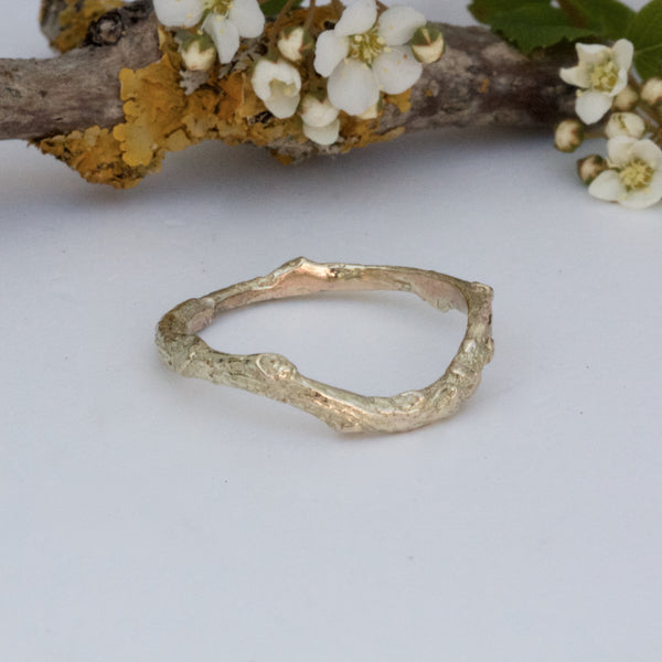 yellow gold shaped twig wedding ring