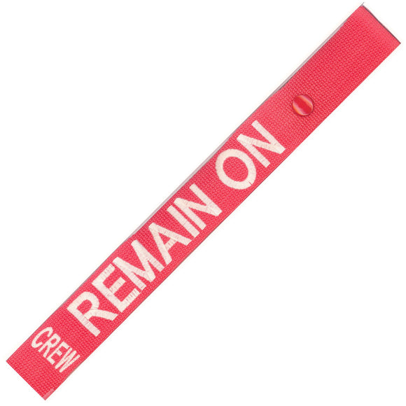 Remain On in White on a Red Bag Tag