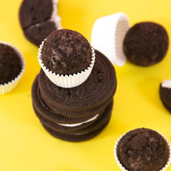 Chocolate Brigadeiro on top of cookie sandwiches