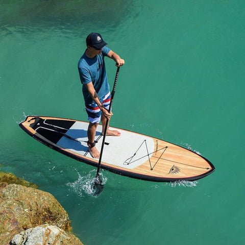 a man on a stand up paddle board