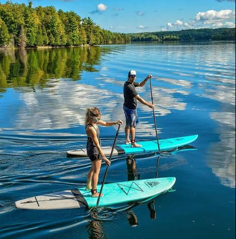Cruiser SUP Escape and paddle boarding on a lake