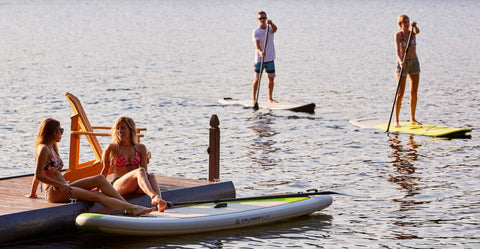 Stand Up Paddle Boarders Enjoying Their Sport