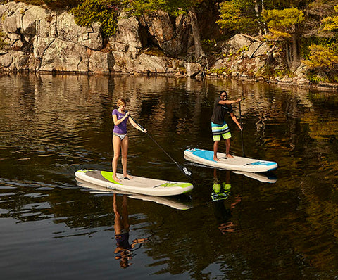 Stand up paddle boarders cruising in calm water