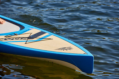A displacement nose stand up paddle board