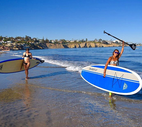 stand up paddle boarder carrying Cruiser Eco Dura-Maxx