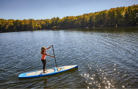 a paddle boarder riding flat water