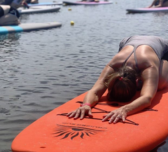 doing SUP Yoga