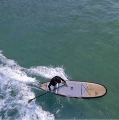 riding a stand up paddle board