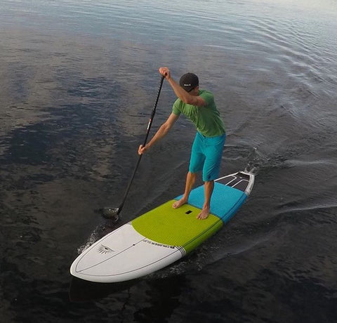 A paddle boarder showing proper form