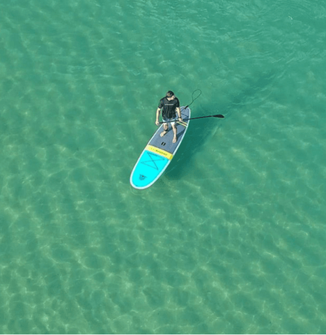 open water paddle boarder