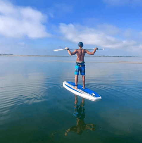 a man stand up paddle boarding