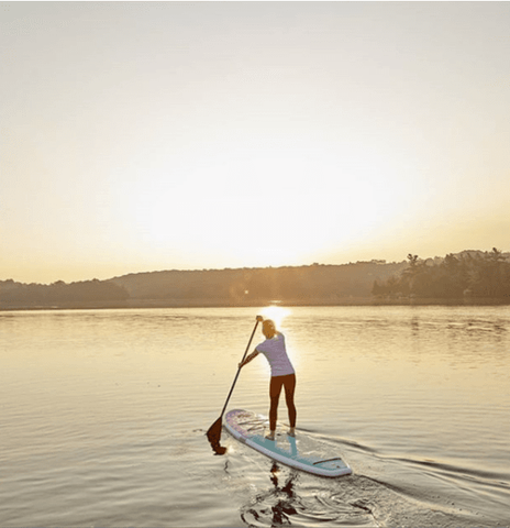 female paddle boarder on a lake