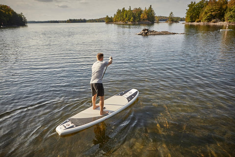 Paddle Boarder using Inflatable Paddle Board