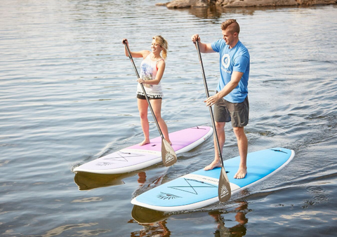 Stand Up Paddle Boarders Riding the Cruiser SUP Kona and Wahine Wood