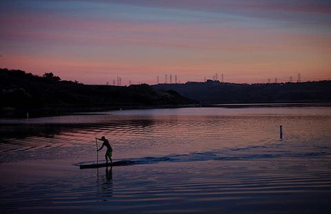 Stand Up Paddle Boarder in calm water
